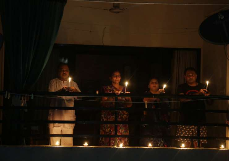 A family holds candles to mark the country's fight against the Covid-19 pandemic in Ahmedabad, Sunda - India Tv
