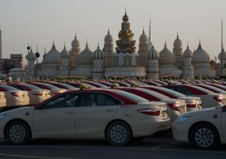Hundreds of taxi cabs stand parked at the shopping theme park Global Village in Dubai, United Arab E - India Tv