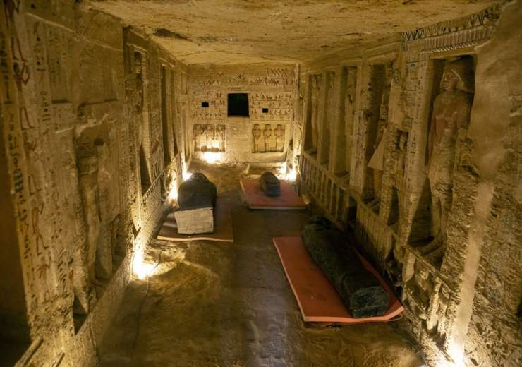 Several sarcophagi are displayed inside a tomb at the Saqqara archaeological site, 30 kilometers (19 - India Tv