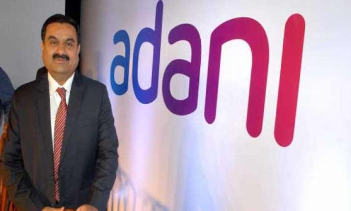 adani group stocks surge as exit polls predict nda win