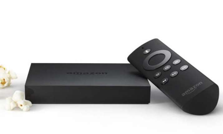 amazon launches internet based tv set top box fire tv