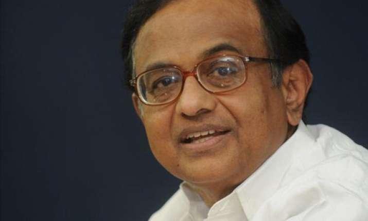 chidambaram cites challenged economy for dull budget