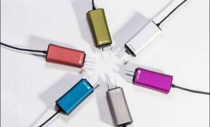 dart a tiny laptop charger will even juice up your phone at