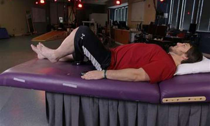 electrical device helps paralyzed men move legs