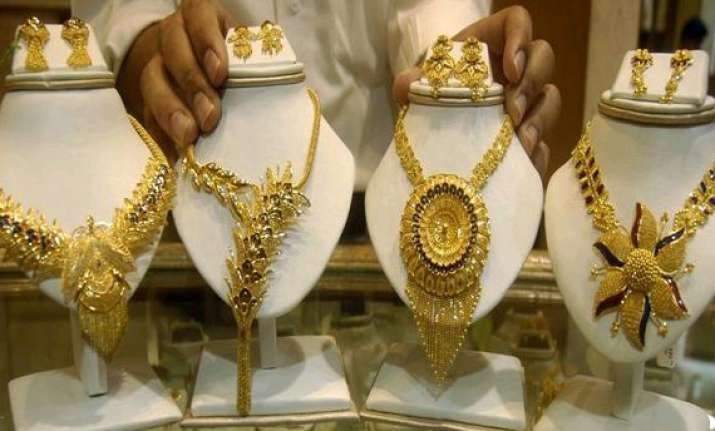 gold dips on subdued demand weak global cues