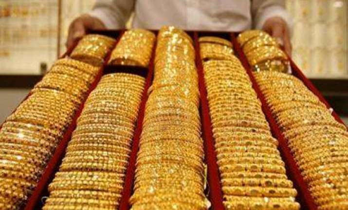 gold down by rs 100 on weak global cues silver recovers