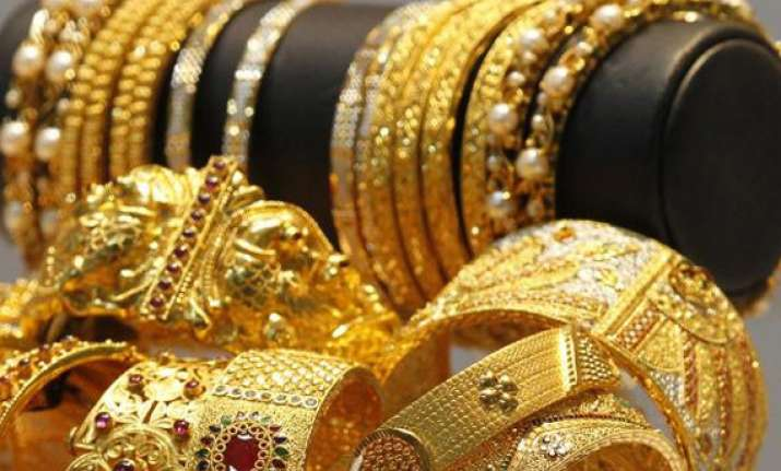 gold down by rs 330 silver by rs 100 on lower sales