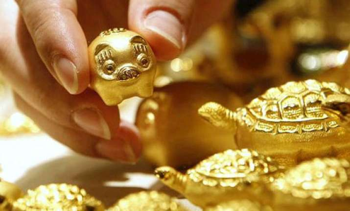 gold ends almost flat in listless trade silver gains