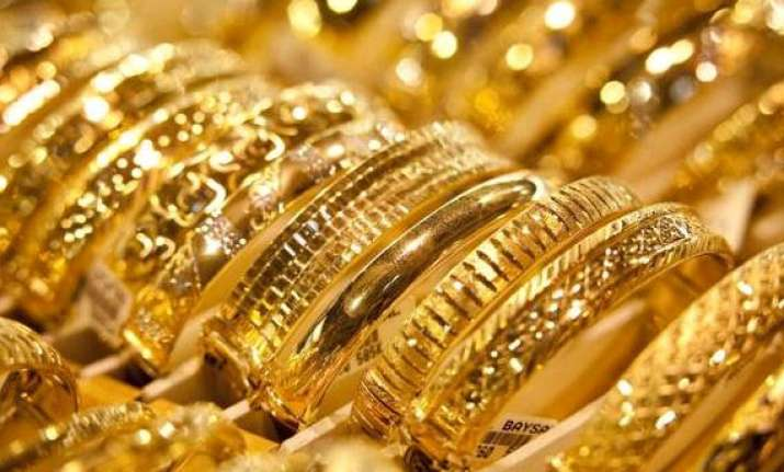 gold futures fall to rs 27 641 on profit booking weak