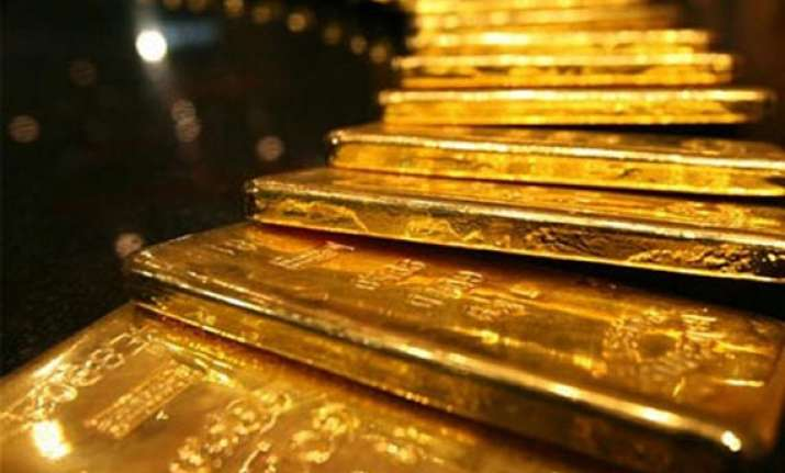 gold gains by rs 310 on stockists buying