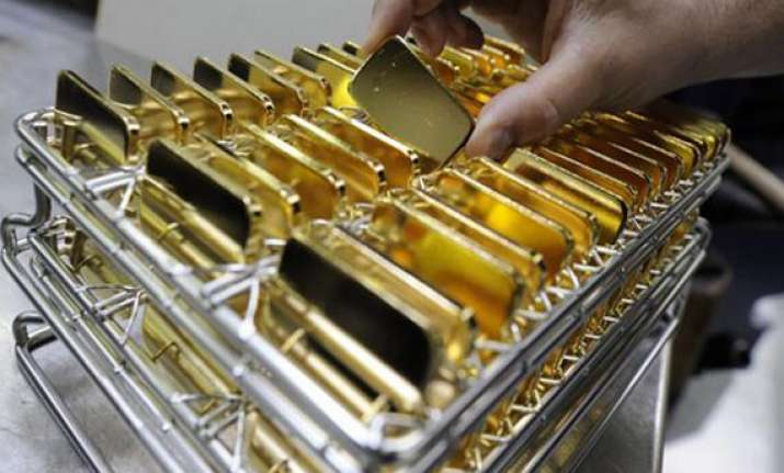 gold plummets to nearly one year low global sell off weighs