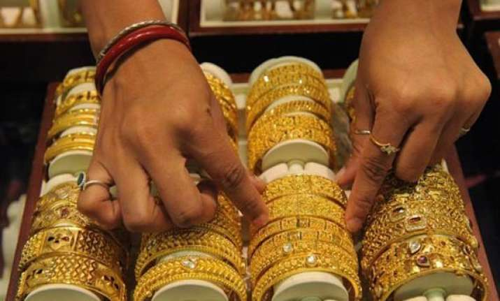 gold recovers on low level buying silver falls