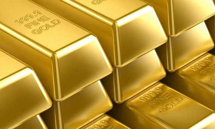 gold slips from nearly 4 month high down rs. 475