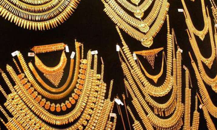 gold advances on rising demand silver slides
