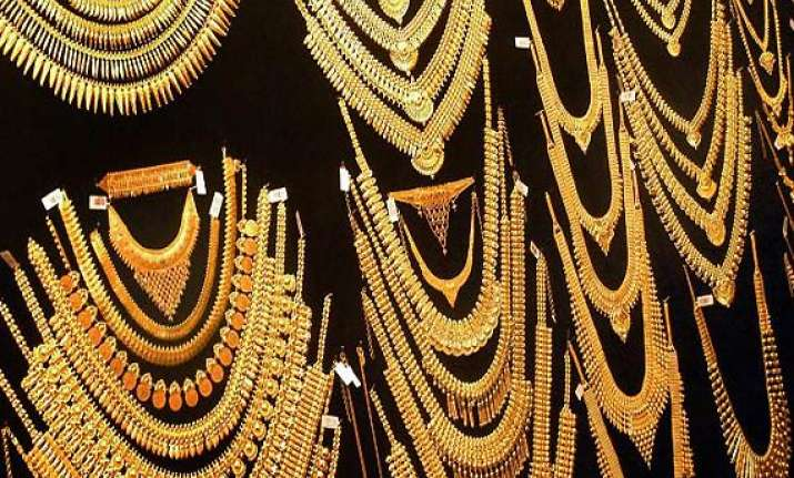 gold eases on reduced jewellery offtake silver declines