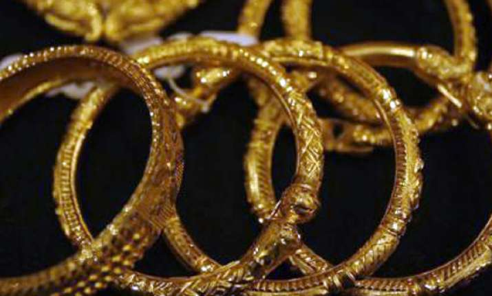 gold falls by rs 180 silver down by rs 500