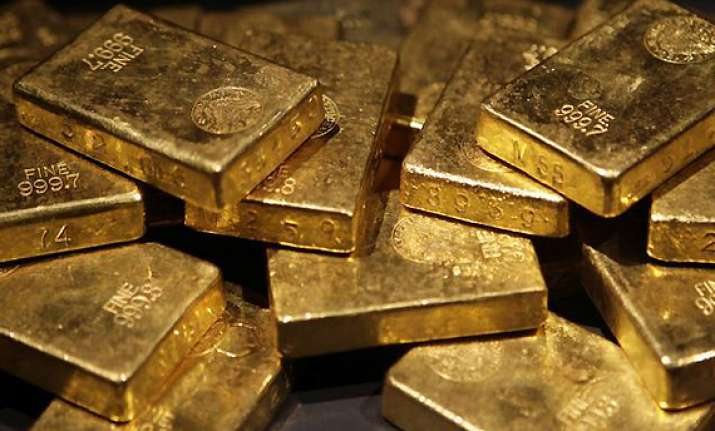 gold loses rs 100 on global cues silver gains rs 50