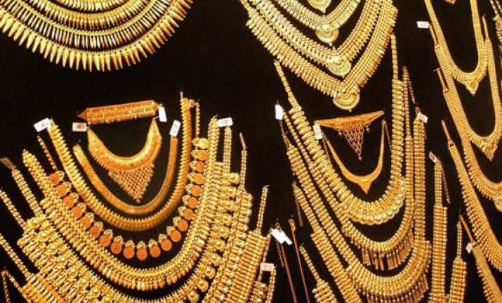 gold moves up by rs 260 silver by rs 500