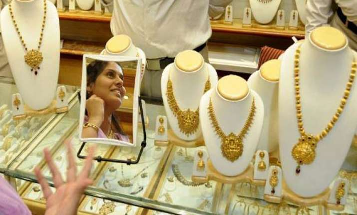 gold slips from record on sluggish demand at higher levels