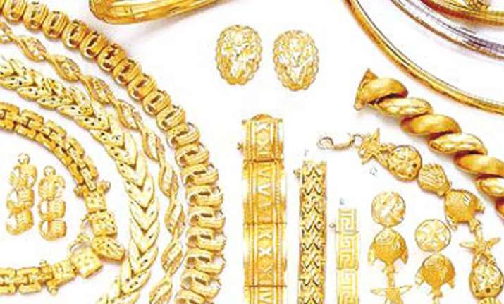 gold up by rs 50 silver falls by rs 170