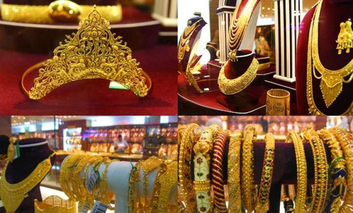 gold prices dip below 31k level