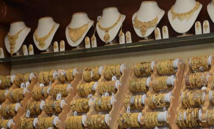 gold silver extend gains on festive demand