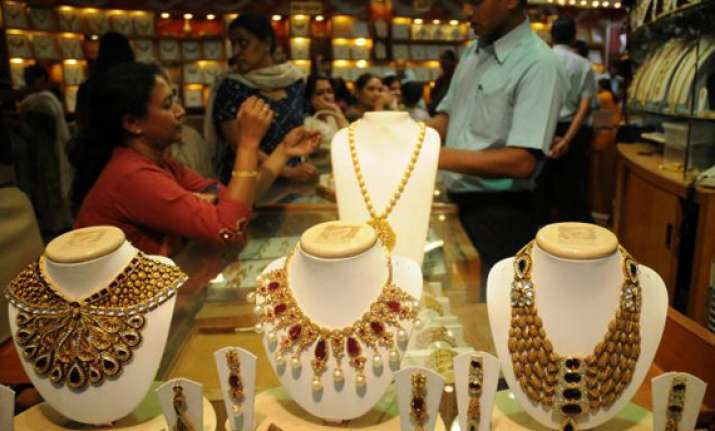 gold slips from record high on fall in demand