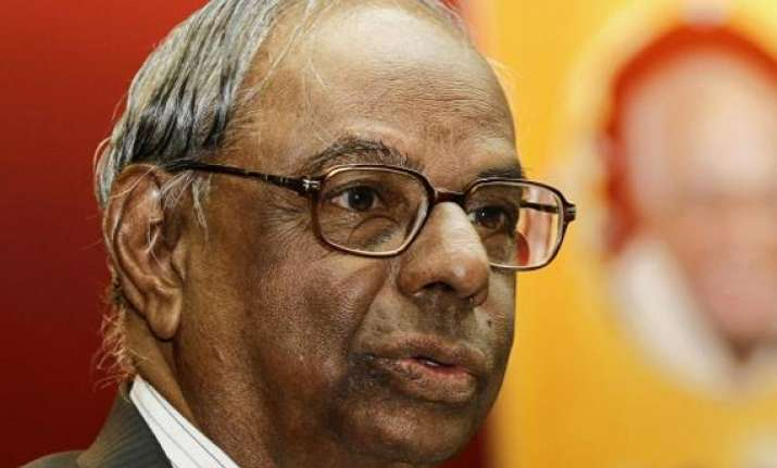 govt determined to contain fiscal deficit says rangarajan