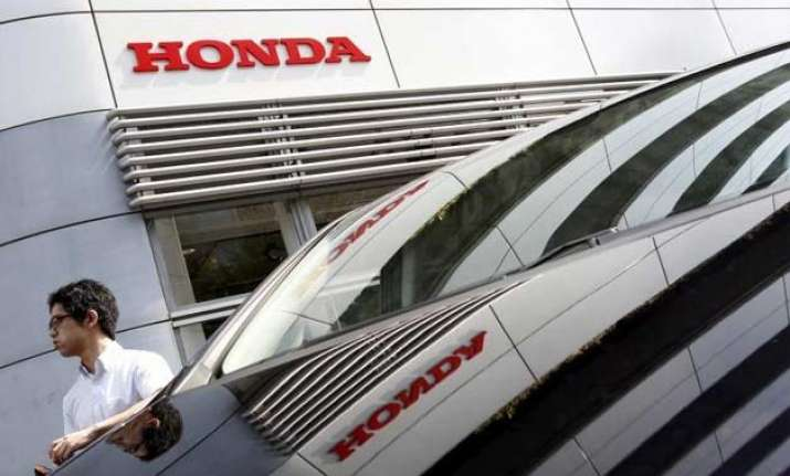 despite recalls honda records 20 profit rise on yen