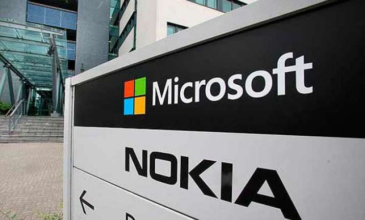 microsoft writes off 7.6 bn in nokia deal to cut 7 800 jobs