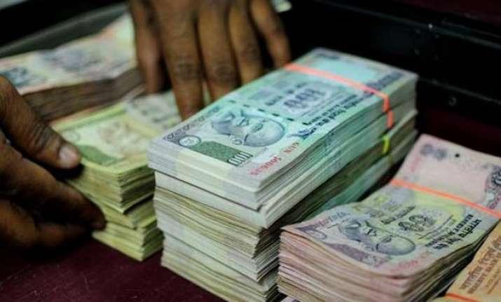 rupee weakens 18 paise against dollar