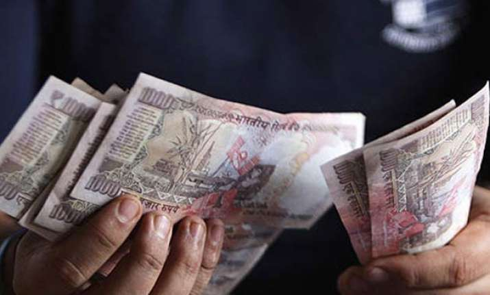 rupee trims initial losses still down 59 paise at 66.42