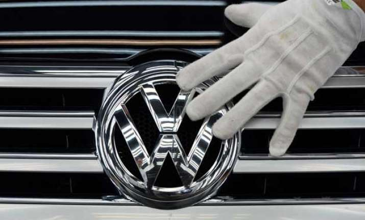 volkswagen suffers first quarterly loss in 15 years lowers