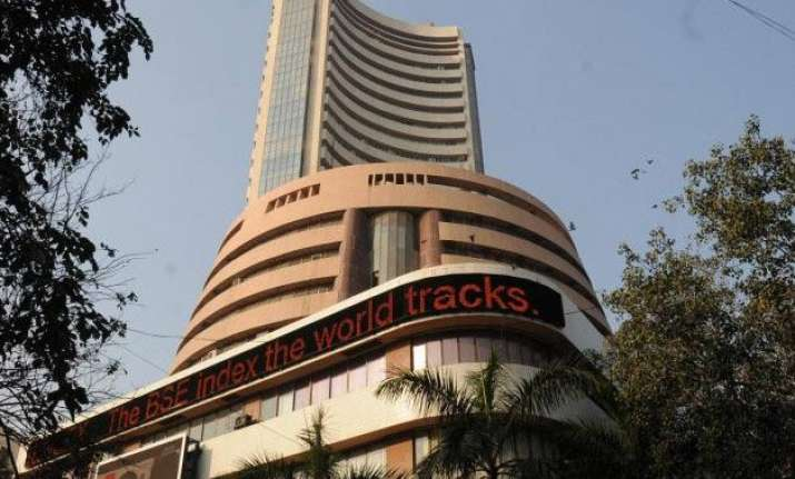 sensex cuts down losses after rbi holds rate