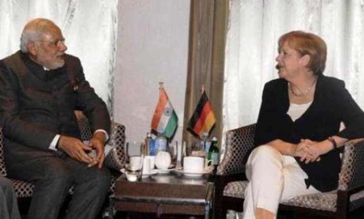 modi merkel seek to give economic muscle to indo german ties
