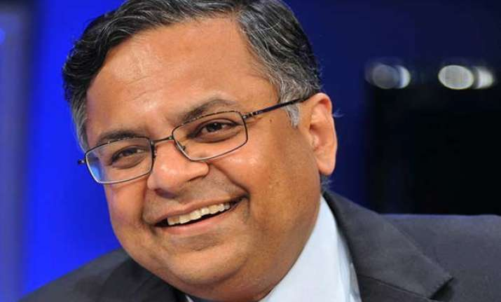 tcs reports marginal slide in net profit at rs 5 328 cr in