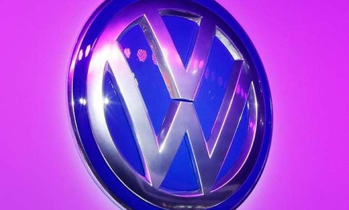 volkswagen sets aside 7.3 billion over emissions scandal