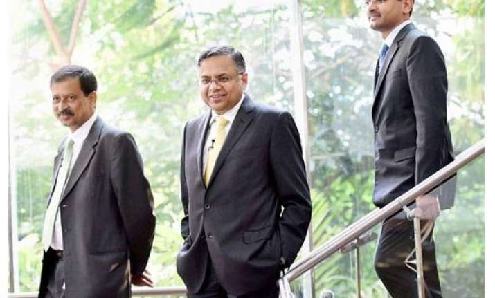 tcs approves merger with cmc