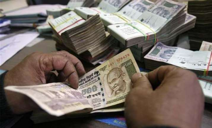 rupee hits 2 week low of 64.01 vs dollar down 3 paise
