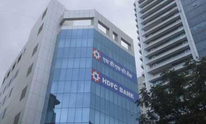 hdfc bank beats street posts 21 hike in profit