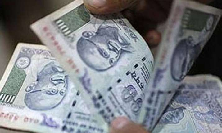 rupee breaches 64 mark hits 20 month low against dollar