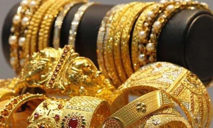gold declines on weak global cues low demand