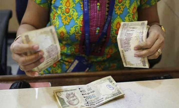 rupee ends lower by 15 paise at 63.82 against us dollar