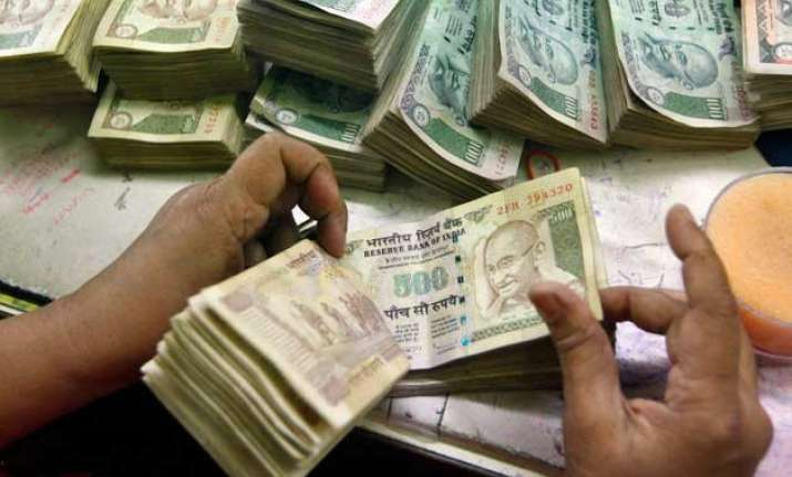 rupee pares initial losses still down 17 paise against