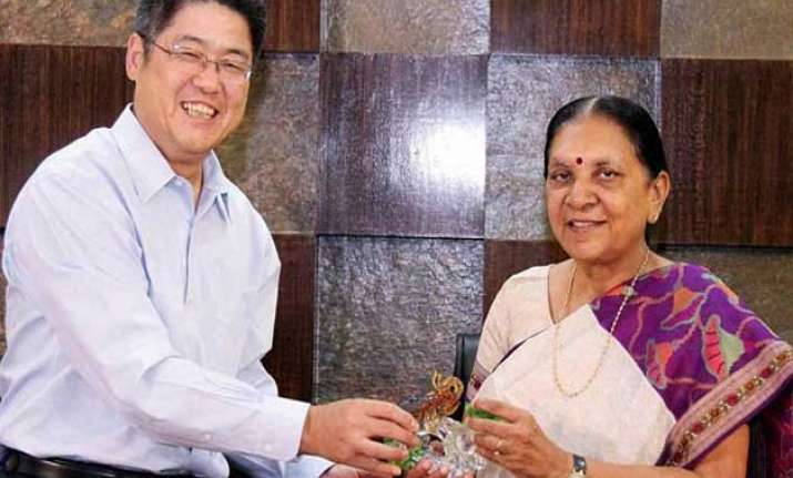 gujarat cm addresses business leaders in china