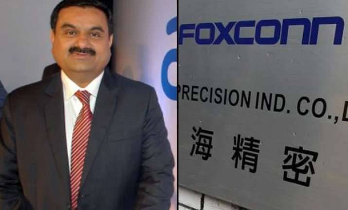 adani may make iphones in india in talks to form jv with