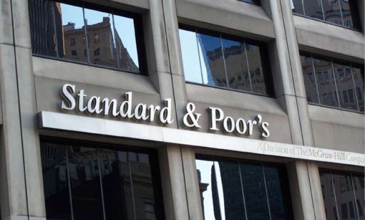 india rejects s p s warning of downgrading its credit rating