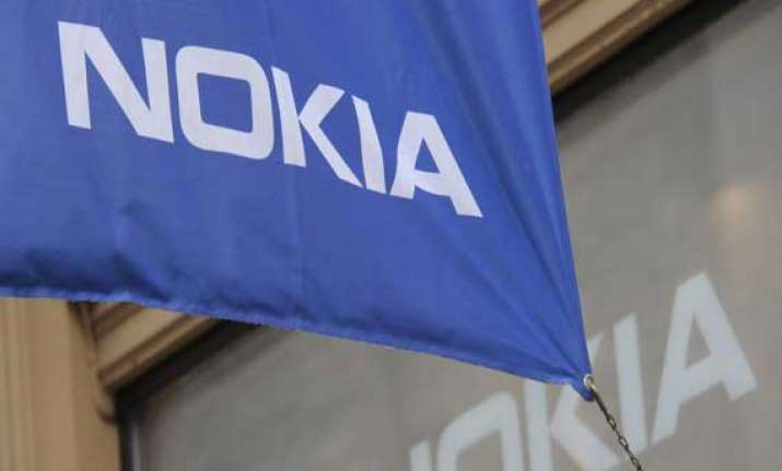 mobile unit drags down nokia q1 results despite sale