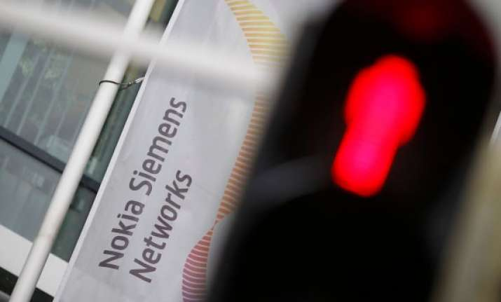 nokia downgraded by s p after nokia siemens networks