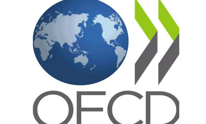 oecd cuts global economic growth forecast to 3.4 percent